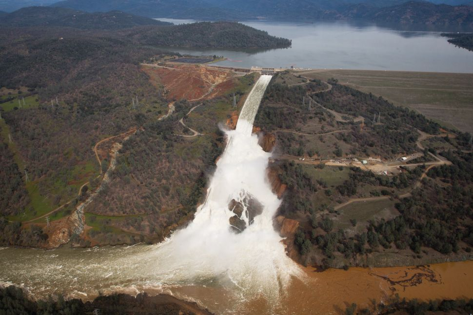 Oroville lake, the emergency spillway, and the damaged main spillway, are seen from the air on February 13, 2017 in Oroville, California. Almost 200,000 people were ordered to evacuate the northern California town after a hole in an emergency spillway in the Oroville Dam threatened to flood the surrounding area.