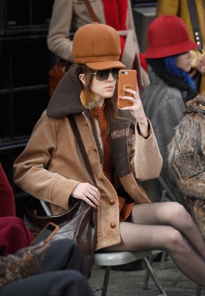Model Teddy Quinlivan snaps some pics on her iPhone.