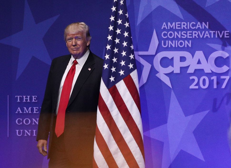 President Donald Trump walks on stage to address CPAC on February 24, 2017.