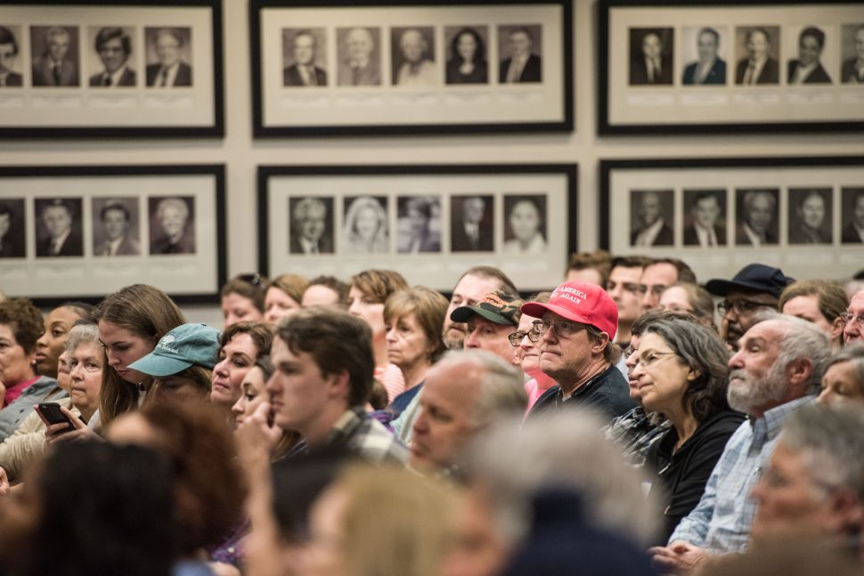 People listen to Sen. Tim Scott during a town hall meeting on February 25, 2017 in North Charleston, SC. Protestors have been showing up in large numbers to congressional town hall meetings across the nation.