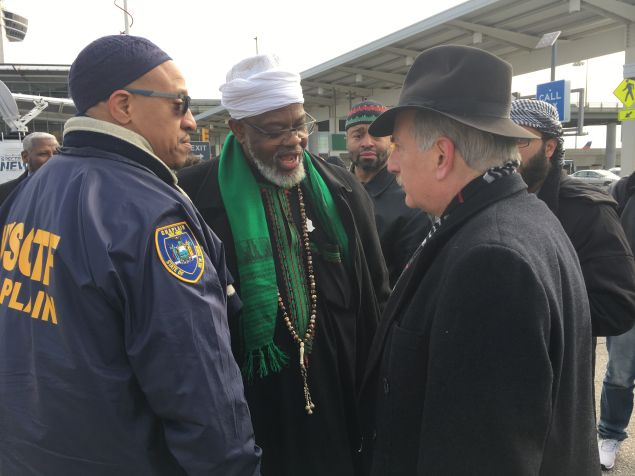 Queens Assemblyman David Weprin chats with Imam Al-Hajj Talib 'Abdur-Rashid of the Mosque of Islamic Brotherhood after an interfaith action at John F. Kennedy International Airport's Terminal 4 Arrivals area.