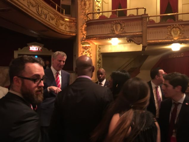 Mayor Bill de Blasio meets with attendees after his State of the City speech at the Apollo Theater in Harlem.