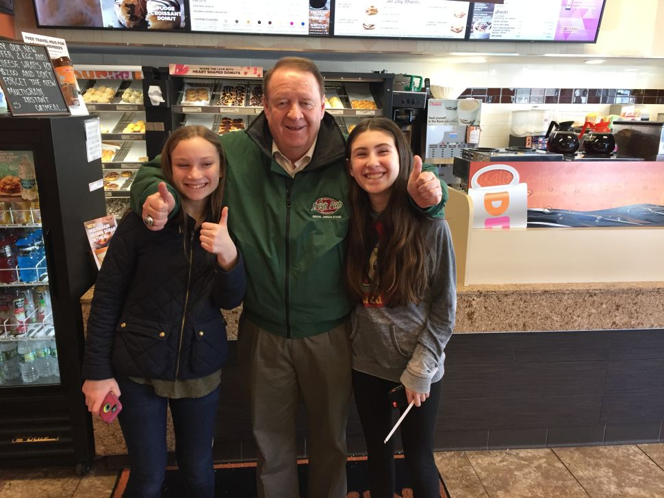 Dick Codey greets two future voters at a Dunkin' Donuts in West Orange.