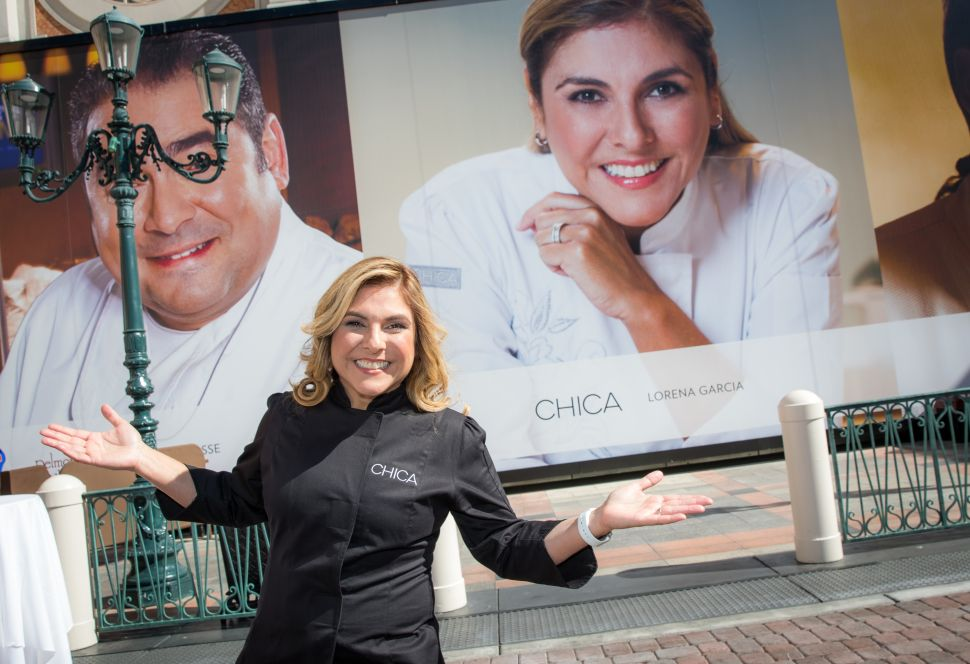 Lorena Garcia and Emeril Lagasse are neighbors at The Venetian.