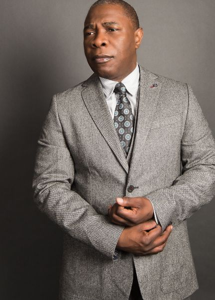 Michael Potts is wearing a Ted Baker suit.