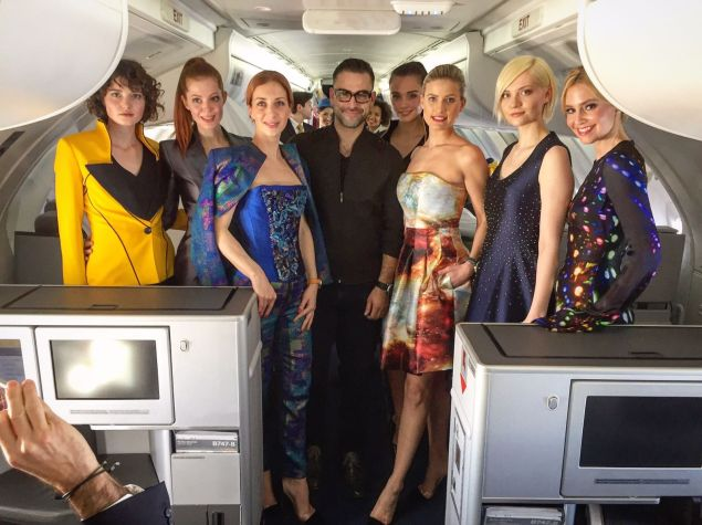 The designer with his models.