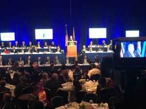 Christie delivers his speech flanked by N.J. senators and members of congress.