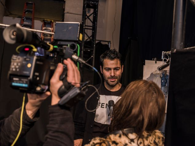 Jonathan Simkhai in interview mode at his fashion show.
