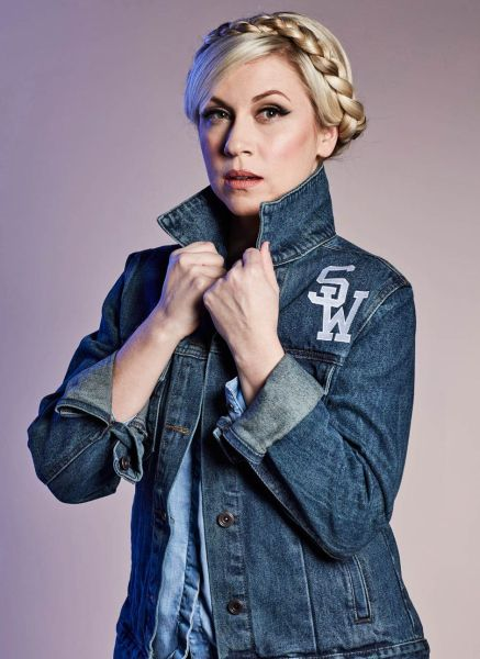 "Her Universe Founder Ashley Eckstein wears the new Star Wars ""May The Force Be With You"" denim jacket which has the famous phrase embroidered on the back. Available at Heruniverse.com."