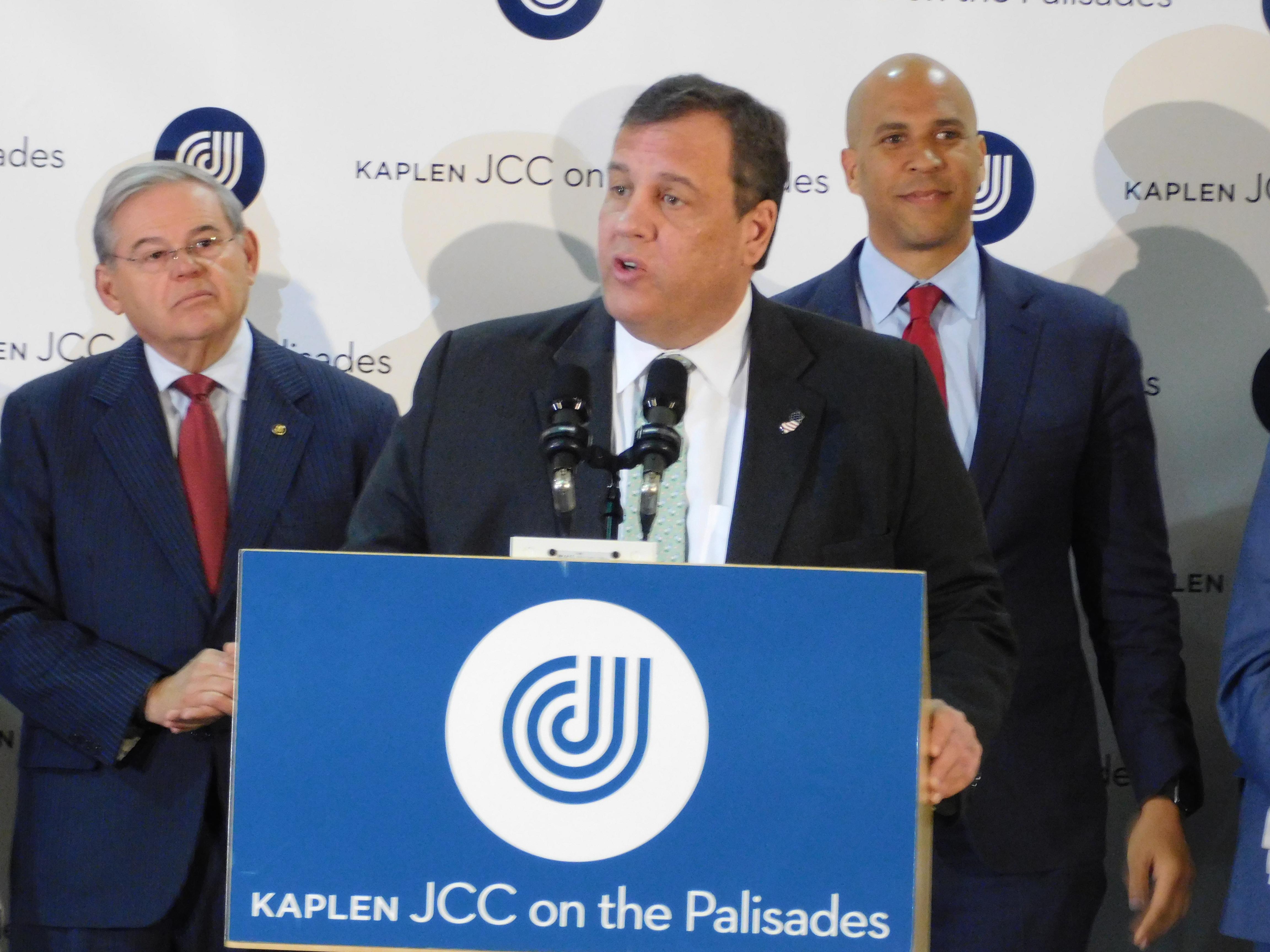 New Jersey Governor Chris Christie stands with U.S. Senators Bob Menendez and Cory Booker.