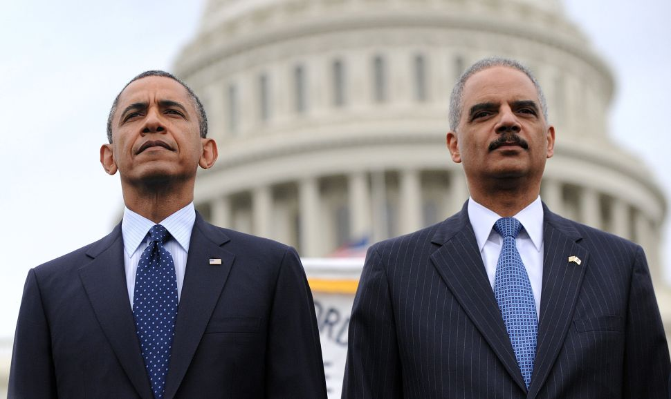 Former President Barack Obama and former Attorney General Eric Holder.