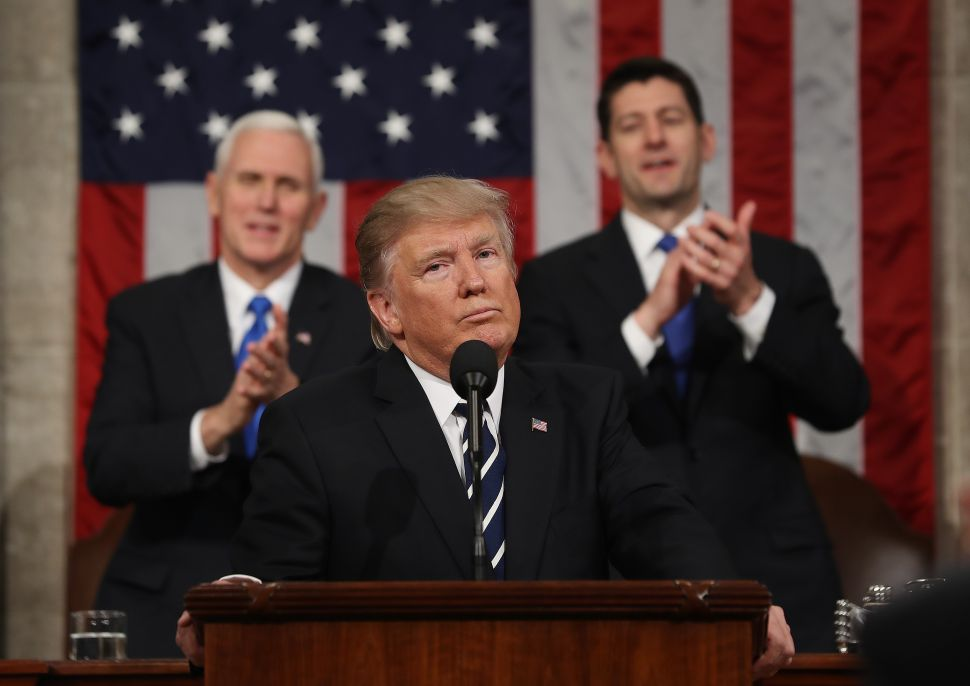 WASHINGTON, DC - FEBRUARY 28: (AFP OUT) U.S. Vice President Mike Pence (L) and Speaker of the House Paul Ryan (R) applaud after U.S. President Donald J. Trump (C) delivers his first address to a joint session of the U.S. Congress on February 28, 2017 in the House chamber of the U.S. Capitol in Washington, DC. Trump's first address to Congress focused on national security, tax and regulatory reform, the economy, and healthcare.