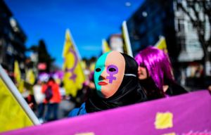 A woman wears a mask as she takes part in a march on March 5, 2017 at Bakirkoy district in Istanbul, ahead of the World women day of March 8, 2017. / AFP PHOTO / BULENT KILIC (Photo credit should read BULENT KILIC/AFP/Getty Images)