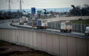 A photo taken on February 2, 2017 in Calais, shows a four-metre-high (13-foot) wall, running along a kilometre-long stretch of the main road leading to Calais port, aimed at stopping migrants who attempt to reach its shores. The wall was built to boost a network of wire fences that had failed to prevent near nightly attempts by migrants to waylay trucks en route to Europe's second-busiest port. Calais has for years been a staging post for attempts by migrants to sneak into Britain by stowing away on trucks or trains crossing the Channel. / AFP / PHILIPPE HUGUEN (Photo credit should read PHILIPPE HUGUEN/AFP/Getty Images)