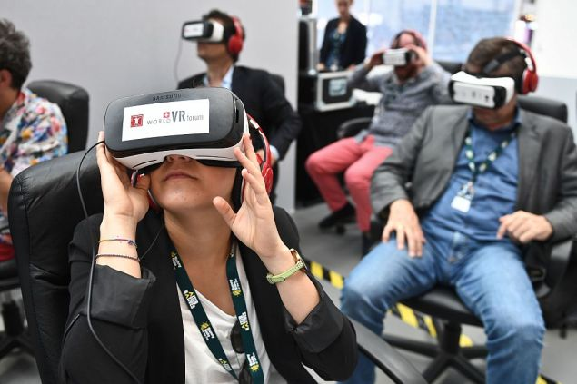 "People test out Samsung's Gear VR powered by Oculus during ""Sunny Side of the Doc"", an international market for documentary films, in La Rochelle on June 21, 2016. / AFP / XAVIER LEOTY (Photo credit should read XAVIER LEOTY/AFP/Getty Images)"