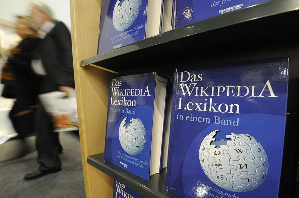 "Copies of the ""One-Volume Wikipedia Encyclopaedia"" are on display at the Frankfurt Book Fair on October 16, 2008. The volume is made up of 50,000 of the most-searched terms on the German language edition of Wikipedia, and represents the first print version of the now-famous online encyclopaedia. Turkey is guest of honour at the 60th edition of the book fair, which takes place from October 15 to 19, 2008. AFP PHOTO / JOHN MACDOUGALL (Photo credit should read JOHN MACDOUGALL/AFP/Getty Images)"