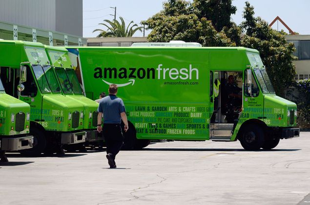INGLEWOOD, CA - JUNE 27: An Amazon Fresh truck arrives at a warehouse on June 27, 2013 in Inglewood, California. Amazon began groceries and fresh produce delivery on a trial basis to select Los Angeles neighberhoods free of charge for Amazon Prime members. AmazonFresh lets you order groceries and have them delivered on the same day. (Photo by Kevork Djansezian/Getty Images)