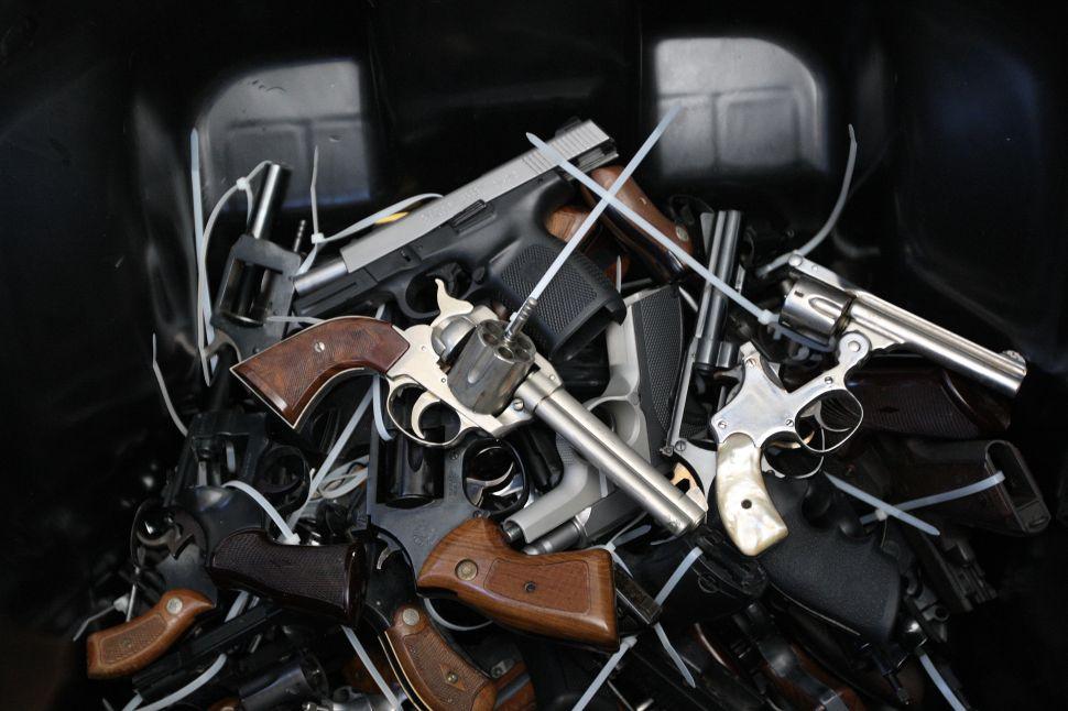 Surrendered handguns in a bin in Los Angeles.