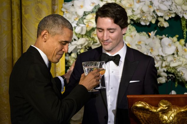 Barack Obama and Justin Trudeau casually toasting as friends do.