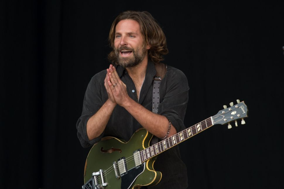 Bradley Cooper plays a guitar as he is filmed for a re-make of the film 'A Star Is Born', on the Pyramid Stage at the Glastonbury Festival of Music and Performing Arts on Worthy Farm near the village of Pilton in Somerset, south-west England on June 23,