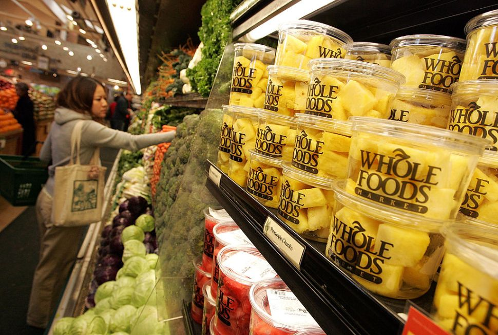 SAN FRANCISCO - FEBRUARY 22: A customer shops for produce at a Whole Foods Market February 22, 2007 in San Francisco, California. Whole Foods Market Inc. announced that it plans to purchase Wild Oats Market Inc. for an estimated $565 million in hopes of competing with larger food chains that have started to introduce organic and prepared foods to their inventories. (Photo by Justin Sullivan/Getty Images)