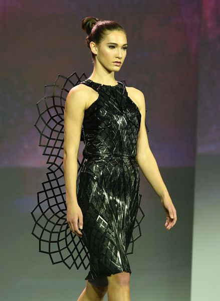 LAS VEGAS, NV - JANUARY 05: A model presents the Chromat Adrenaline Dress made of 3D-printed panels and featuring Intel's Curie Module during a keynote address by Intel Corp. CEO Brian Krzanich at CES 2016 at The Venetian Las Vegas on January 5, 2016 in Las Vegas, Nevada. When the dress senses adrenaline from the wearer, it expands. CES, the world's largest annual consumer technology trade show, runs from January 6-9 and is expected to feature 3,600 exhibitors showing off their latest products and services to more than 150,000 attendees. (Photo by Ethan Miller/Getty Images)