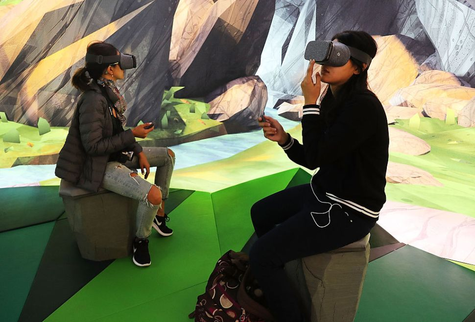 NEW YORK, NY - OCTOBER 20: Women try the Google Daydream VR at the new Google pop-up shop in the SoHo neighborhood on October 20, 2016 in New York City. The shop lets people try out new Google products such as the Pixel phone, Google Home, and Daydream VR. The products will be available for purchase offsite at Verizon and Best Buy retail stores. (Photo by Spencer Platt/Getty Images)