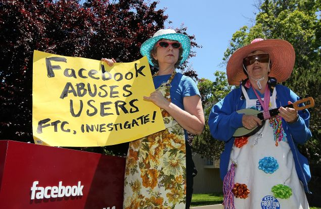 PALO ALTO, CA - JUNE 04: Ruth Robertson (L) and Shirley Powers of the group Raging Grannies stage a demonstration outside of the FaceBook headquarters June 4, 2010 in Palo Alto, California. The group was calling for the FTC to investigate FaceBook's privacy policies. (Photo by Justin Sullivan/Getty Images)