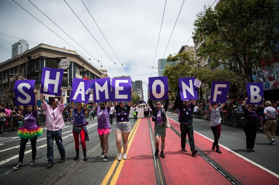 SAN FRANCISCO, CA- JUNE 28: San Francisco Gay Pride Parade marchers protest Facebook not allowing transgender people from choosing their own name, rather than birth name on the social networking site, June 28, 2015 in San Francisco, California. The 2015 pride parade comes two days after the U.S. Supreme Court's landmark decision to legalize same-sex marriage in all 50 states. (Photo by Max Whittaker/Getty Images)