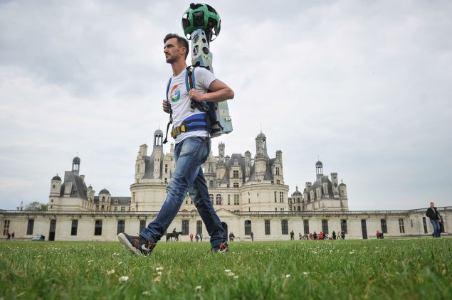 A picture taken on May 17, 2016 shows a Google Tracker Man walking around the Chambord Castle and taking panoramic pictures for the Google map and Google Street in Chambord. Internet Giant Google extends its virtual territory after signing partnerships with 18 castles of the Loire which can now be virtually visited, besides 1000 museums and cultural institutions. / AFP / GUILLAUME SOUVANT (Photo credit should read GUILLAUME SOUVANT/AFP/Getty Images)