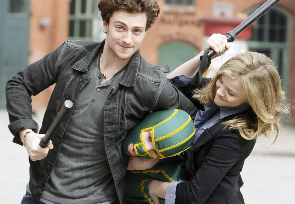 BERLIN - MARCH 30: Actor Aaron Johnson, superhero character and actress Chloe Moretz attend the photocall of 'Kick-Ass' at Kulturbrauerei on March 30, 2010 in Berlin, Germany. (Photo by Florian Seefried/Getty Images)