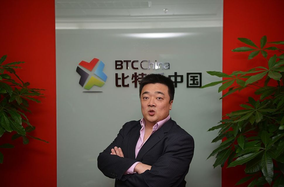 Photo taken on December 4, 2013 shows Bobby Lee, CEO and Co-Founder of BTC China, China's bitcoin exchange at his office in Shanghai. Chinese investors are pouring billions into the virtual Bitcoin currency, driving its price to almost the level of an ounce of gold, but stoking fears of a huge and unsustainable bubble. AFP PHOTO/Peter PARKS (Photo credit should read PETER PARKS/AFP/Getty Images)