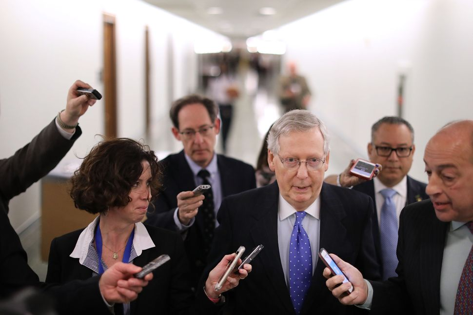 Senate Majority Leader Mitch McConnell (R-KY) talks with reporters after leaving a tax reform news conference in on Capitol Hill on November 30, 2017 in Washington, D.C.