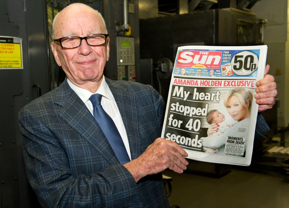 Rupert Murdoch, Chairman and CEO of News Corporation, reviews the first edition of The Sun On Sunday as it comes off the presses on February 25, 2012 in Broxbourne, England.