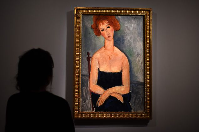 Red-headed Woman wearing a Pendant by Amedeo Modigliani, not one of the Modiglianis recently deemed to be forgeries.