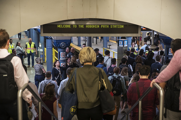 Commuters head from New Jersey Transit trains to PATH trains during a morning commute to Penn Station.