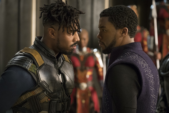 Michael B. Jordan as Erik Killmonger and Chadwick Boseman as Black Panther.