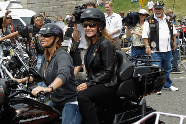 """Sarah Palin rides on the back of a Harley-Davidson before the """"Rolling Thunder"""" in Arlington, Virginia."""