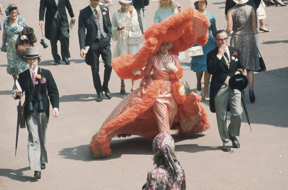 20th June 1969: At Ascot races Mrs Gertrude Shilling in an apricot coloured, feather trimmed out fit, which is completed by an enormous, matching, cartwheel hat.