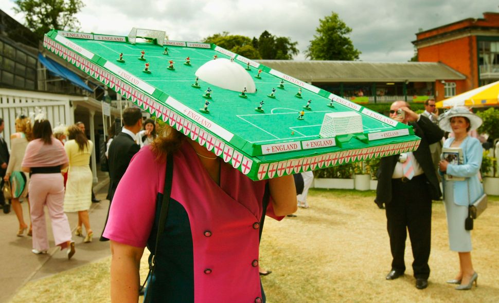 BERKSHIRE, ENGLAND - JUNE 17: An England supporter wears an extravagant hat in the shape of a mini football pitch during Ladies Day on the third day of Royal Ascot at the Ascot Racecourse on June 17, 2004 in Berkshire, England.