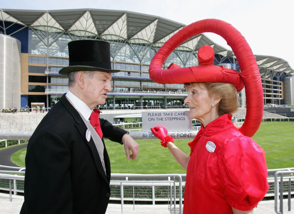 ASCOT, UNITED KINGDOM - JUNE 19: A lady in an elaborate hat talks to a man in a morning suit on the first day of Royal Ascot 2007 on June 19, 2007 in Ascot, England. (Photo by Chris Jackson/Getty Images)