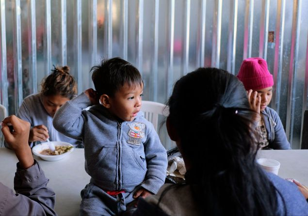 """Central American migrants during the """"Migrant Via Crucis"""" caravan, as they have breakfast at Juventud 2000 shelter in Tijuana, Mexico on April 17, 2018."""
