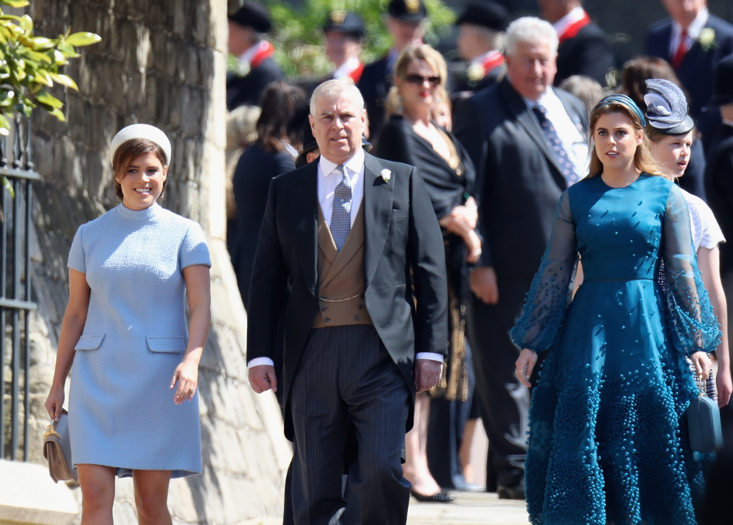 WINDSOR, ENGLAND - MAY 19: (L-R) Princess Eugenie, Prince Andrew, Duke of York and Princess Beatrice attend the wedding of Prince Harry to Ms Meghan Markle at St George's Chapel, Windsor Castle on May 19, 2018 in Windsor, England. Prince Henry Charles Albert David of Wales marries Ms. Meghan Markle in a service at St George's Chapel inside the grounds of Windsor Castle. Among the guests were 2200 members of the public, the royal family and Ms. Markle's Mother Doria Ragland.