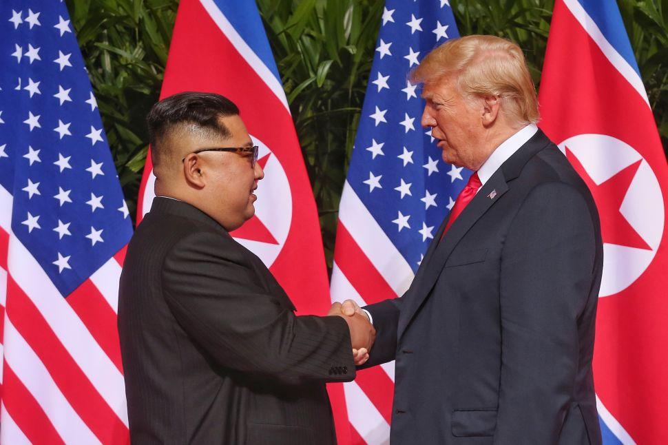 North Korean leader Kim Jong-un shakes hands with U.S. President Donald Trump.