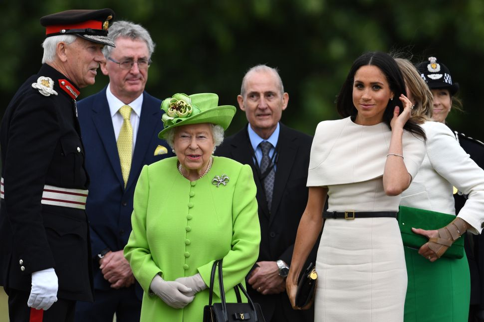 Queen Elizabeth II and Meghan, Duchess of Sussex arrive to open the new Mersey Gateway Bridge on June 14, 2018 in the town of Widnes in Halton, Cheshire, England. Meghan Markle married Prince Harry last month to become The Duchess of Sussex and this is her first engagement with the Queen. During the visit the pair will open a road bridge in Widnes and visit The Storyhouse and Town Hall in Chester. (Photo by Jeff J Mitchell/Getty Images)