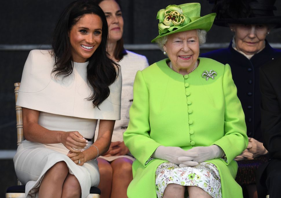 WIDNES, ENGLAND - JUNE 14: Queen Elizabeth II sits with Meghan, Duchess of Sussex during a ceremony to open the new Mersey Gateway Bridge on June 14, 2018 in the town of Widnes in Halton, Cheshire, England. Meghan Markle married Prince Harry last month to become The Duchess of Sussex and this is her first engagement with the Queen. During the visit the pair will open a road bridge in Widnes and visit The Storyhouse and Town Hall in Chester.
