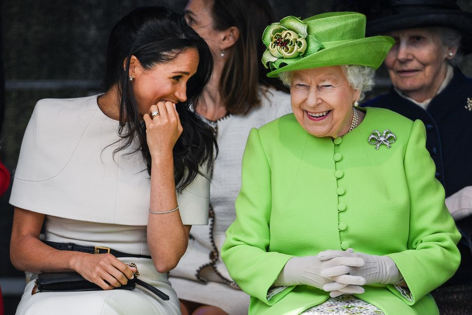 CHESTER, ENGLAND - JUNE 14: Queen Elizabeth II sitts and laughs with Meghan, Duchess of Sussex during a ceremony to open the new Mersey Gateway Bridge on June 14, 2018 in the town of Widnes in Halton, Cheshire, England. Meghan Markle married Prince Harry last month to become The Duchess of Sussex and this is her first engagement with the Queen. During the visit the pair will open a road bridge in Widnes and visit The Storyhouse and Town Hall in Chester.