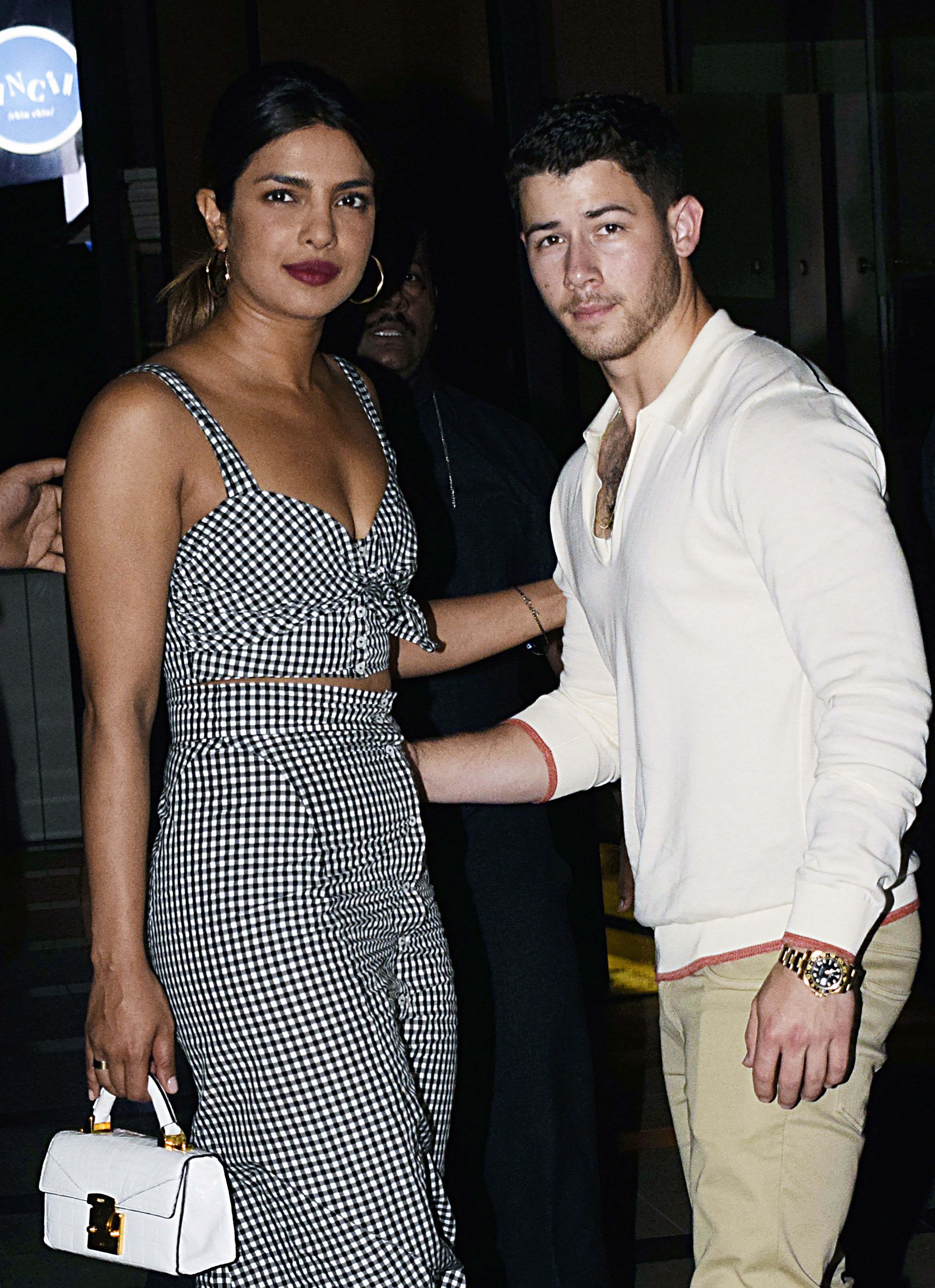 Indian Bollywood actress Priyanka Chopra (L) and US singer Nick Jonas (R) stand together in Mumbai on June 22, 2018.