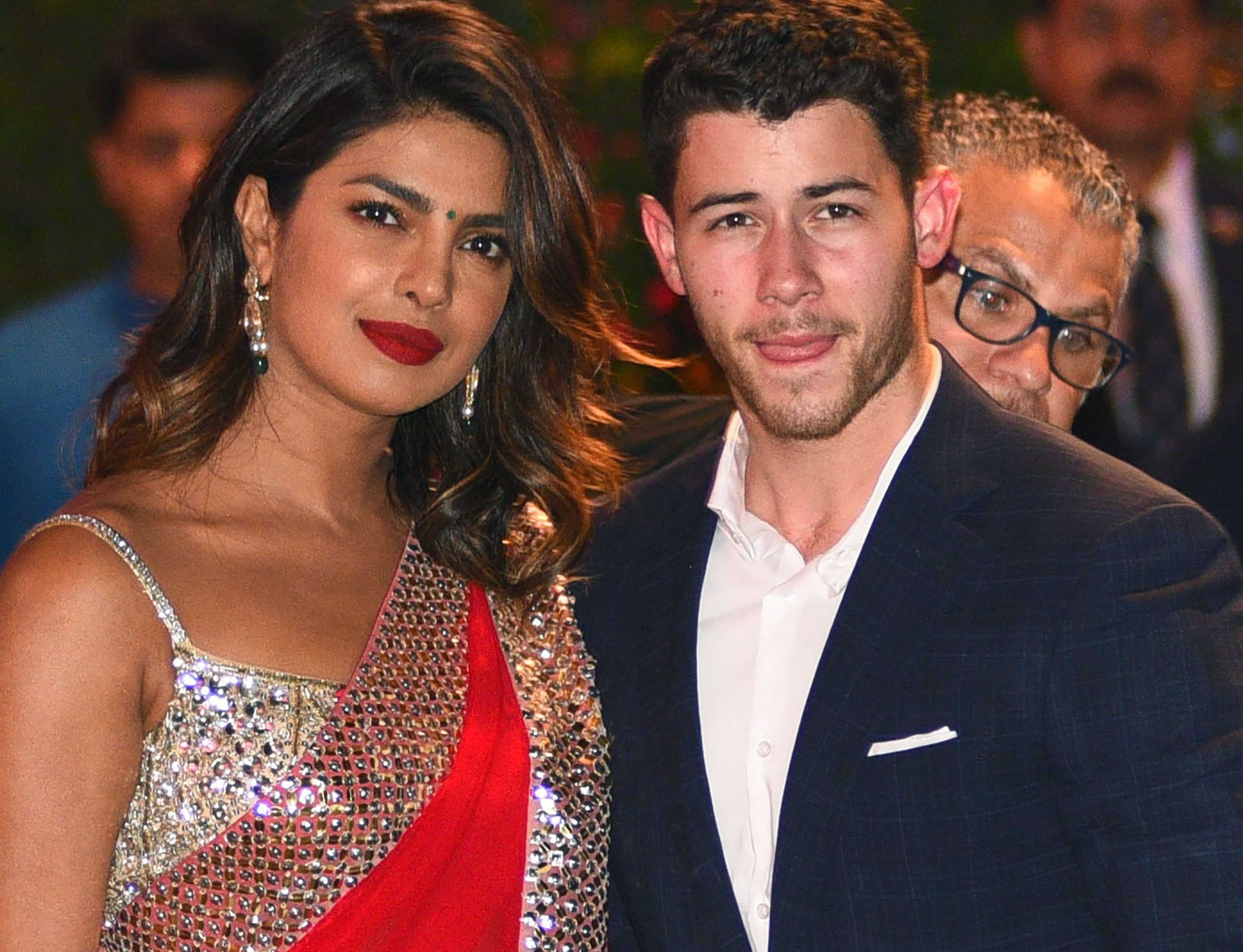 Indian Bollywood actress Priyanka Chopra (L) accompanied by Nick Jonas arrive for the pre-engagement party of India's richest man and Reliance Industries Limited Chairman, Mukesh Ambanis eldest son Akash Ambani and fiancee Shloka Mehta in Mumbai on June 28, 2018.