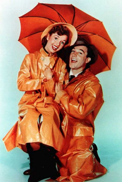 Gene Kelly and Debbie Reynolds pose for the poster of Singin' In the Rain.